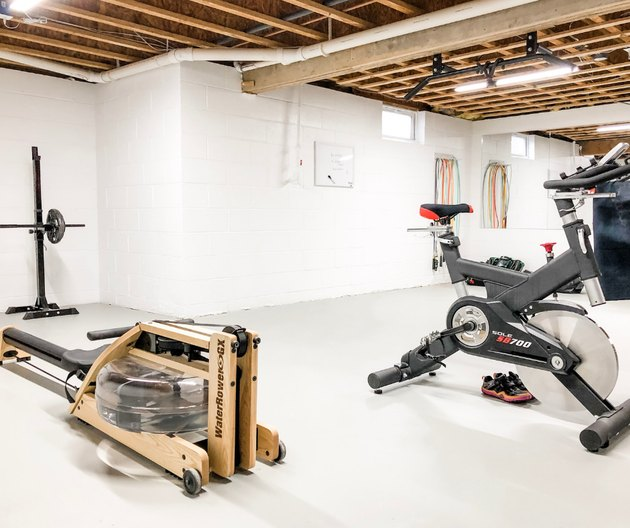 basement gym with wood rafter ceiling