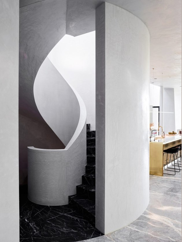 marble and plaster curvilinear black and white stairs
