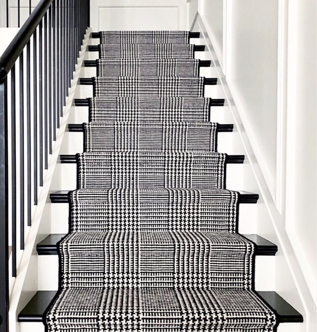 black and white stairs with houndstooth runner
