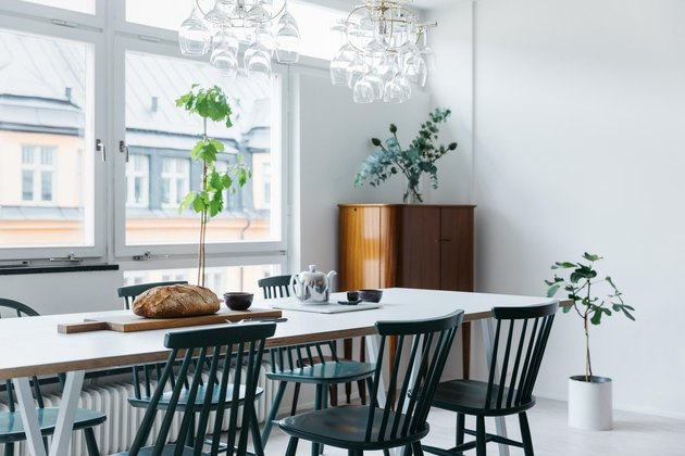 Scandinavian dining room with green dining chairs