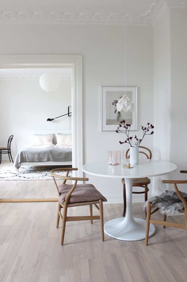 Scandinavian dining room with sheepskin seat cover