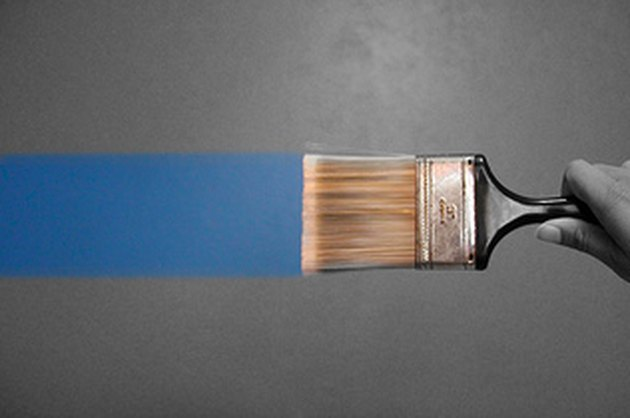 Paintbrush lays a clean line of paint.