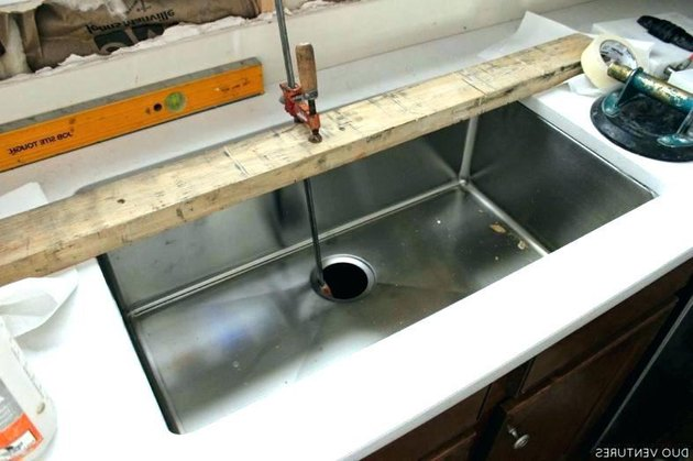Removing undermount sink.