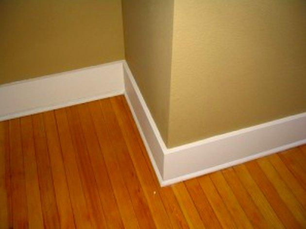 4-inch white baseboards on beige wall.