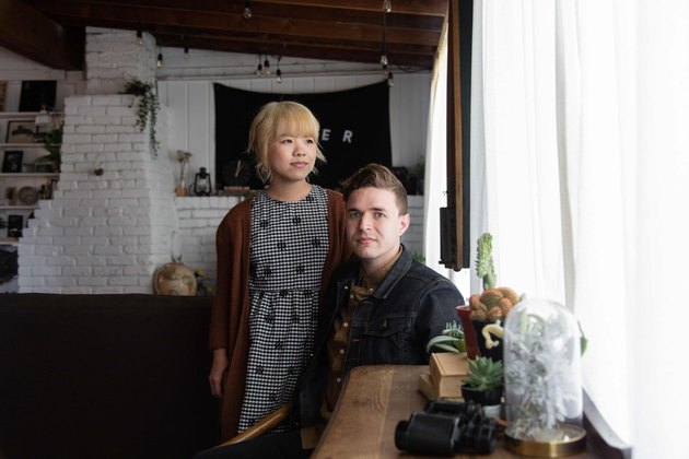 May Xiong and Ben Harthun in their living room.