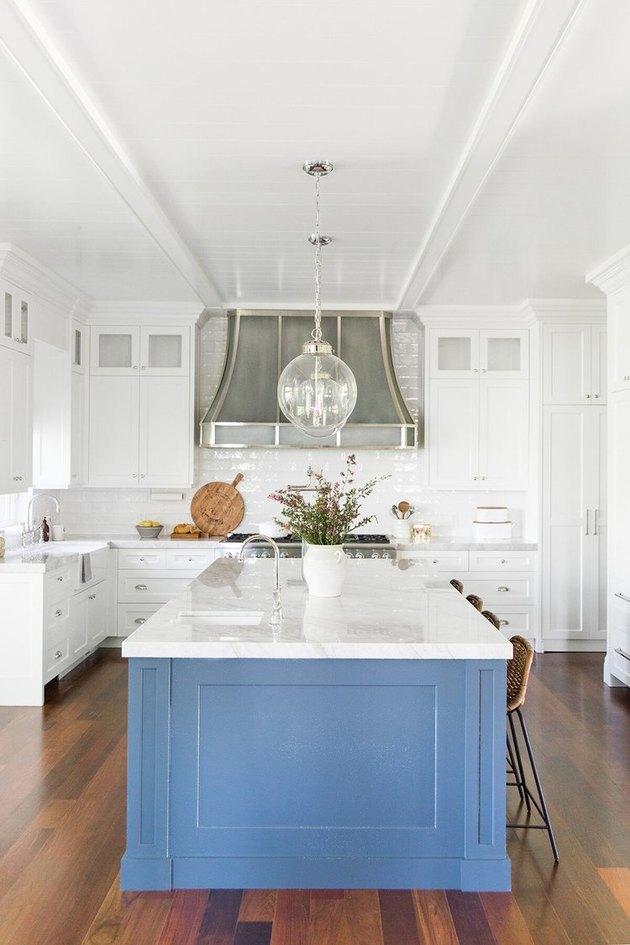 Blue cabinetry with kitchen island sink