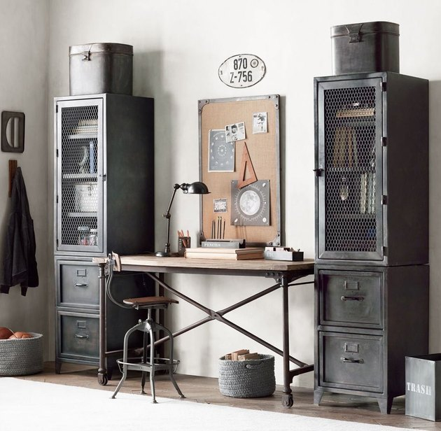 industrial office idea with metal cabinets and cork board on wall