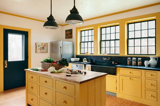yellow kitchen cabinet idea with black trim and small island