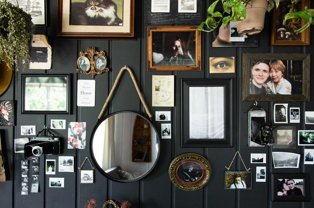 Charcoal wall of objects in living room.