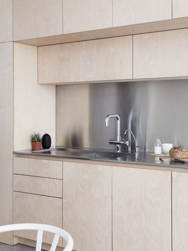 stainless steel kitchen backsplash with wood cabinets