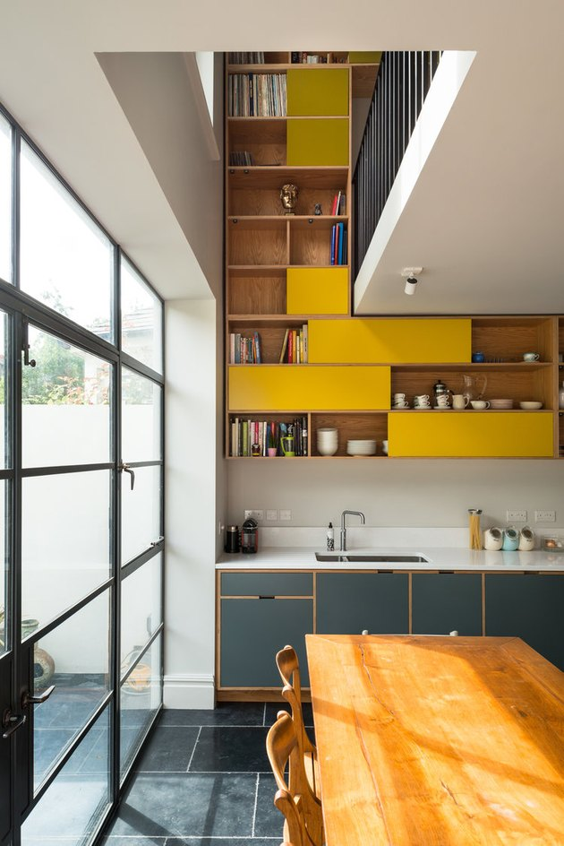 yellow kitchen cabinet idea with lower blue cabinets and upper yellow cabinets