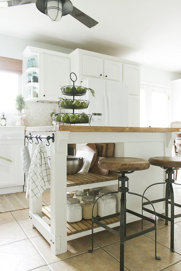 Farmhouse kitchen island storage with wood countertop