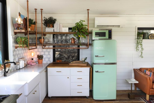 small white kitchen with copper accents