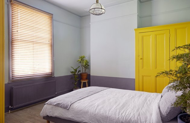 bedroom with yellow dresser