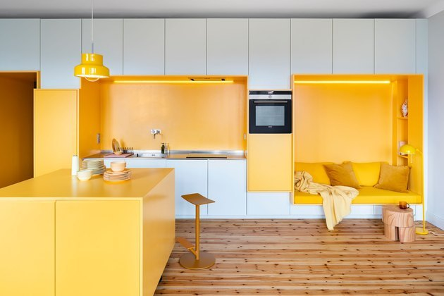 contemporary yellow kitchen color idea with wood flooring