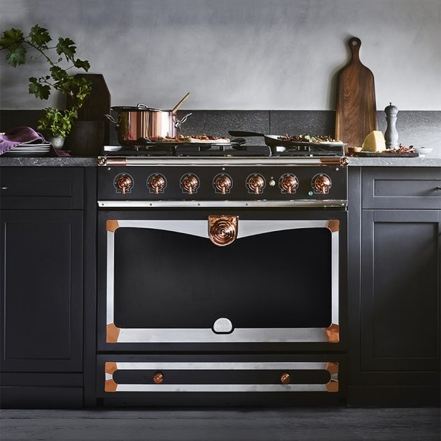 copper and black stove in kitchen