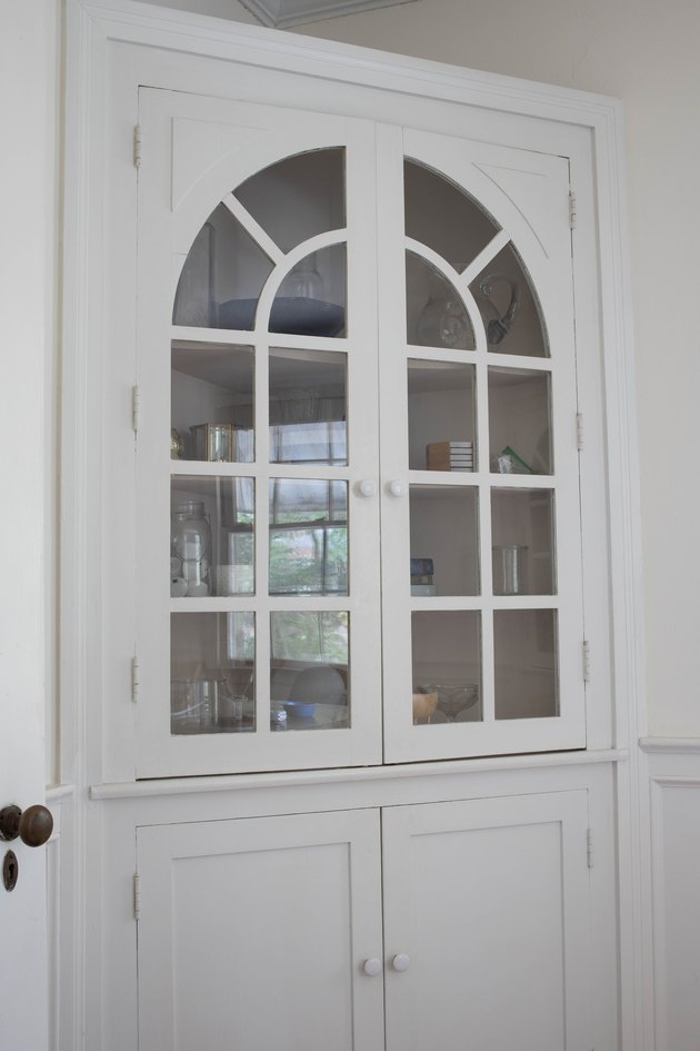 White corner cabinet with white knobs