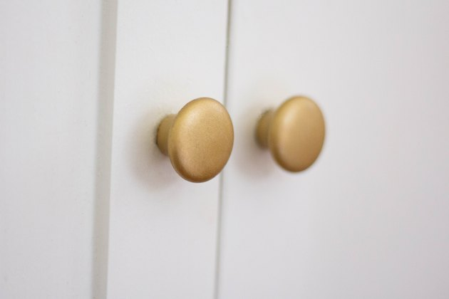 Cabinet knobs painted with a raw brass finish