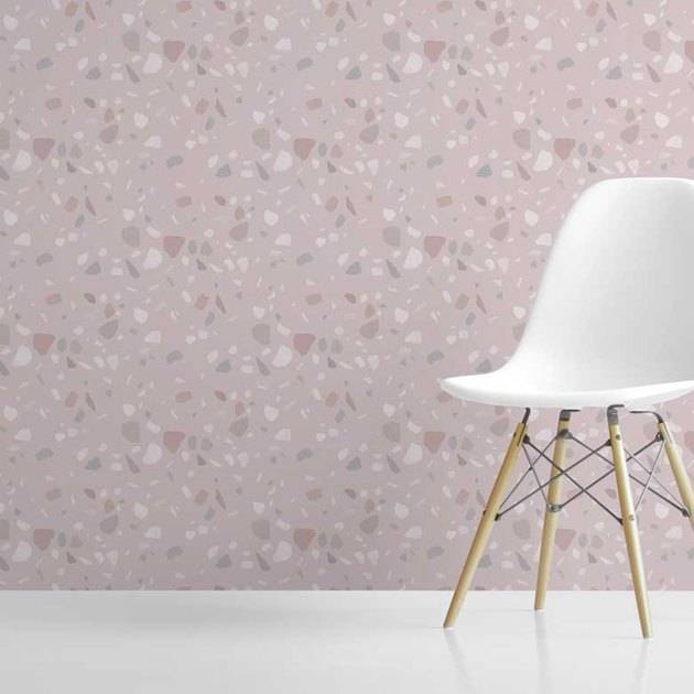 pink terrazzo wallpaper with white chair