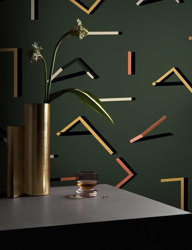 dark green geometric wallpaper and plant