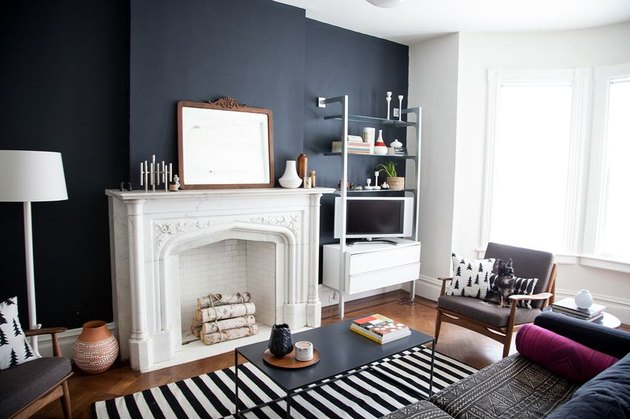 black living room walls with white fireplace