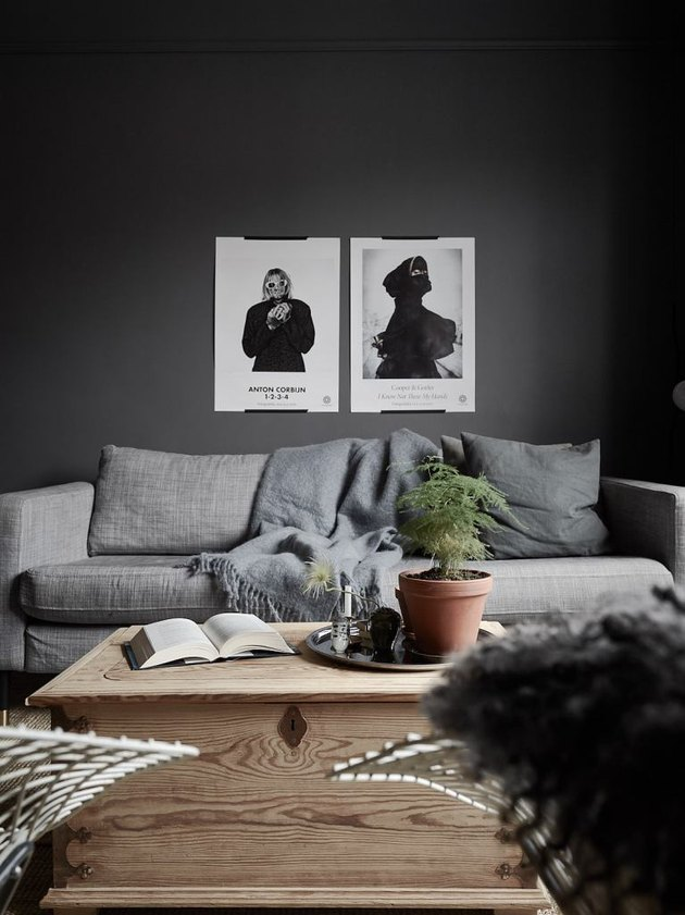 minimalist living room with black walls