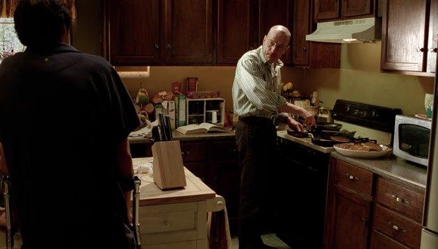 screenshot of man cooking in kitchen