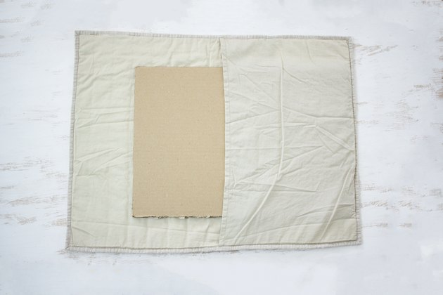 Placing cardboard inside pillow sham