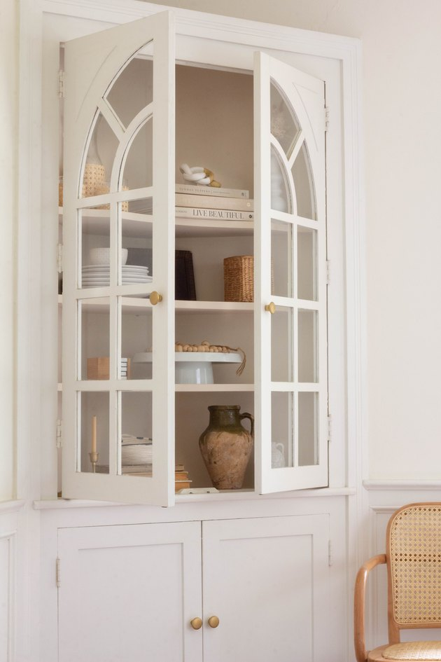 White corner cabinet with brass knobs