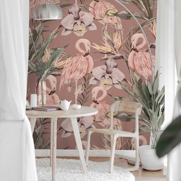 table and chair with flamingo wallpaper in the background