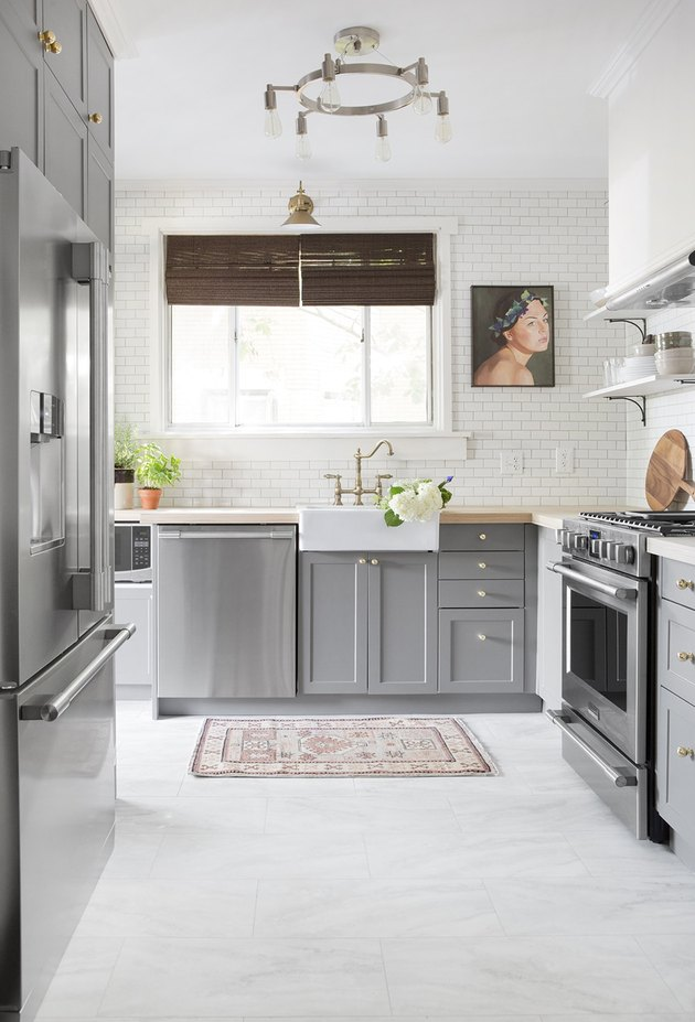 marble kitchen vinyl flooring with gray cabinets and farmhouse sink