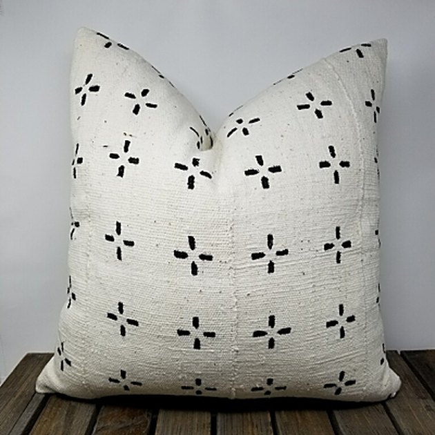 White square throw pillow with small black criss-crosses