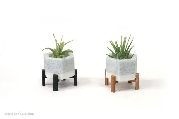 two mini planters with stands