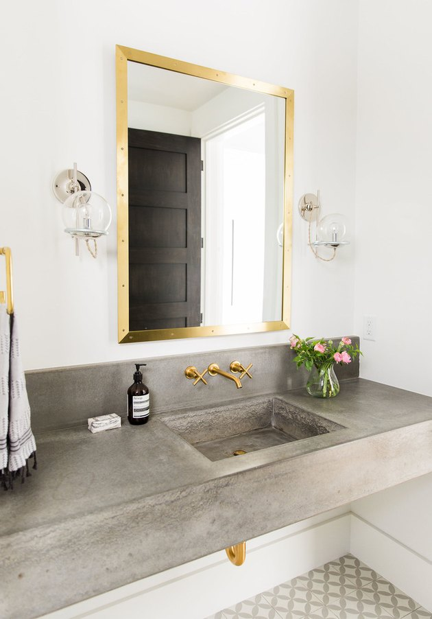 bathroom with concrete countertop and integrated sink
