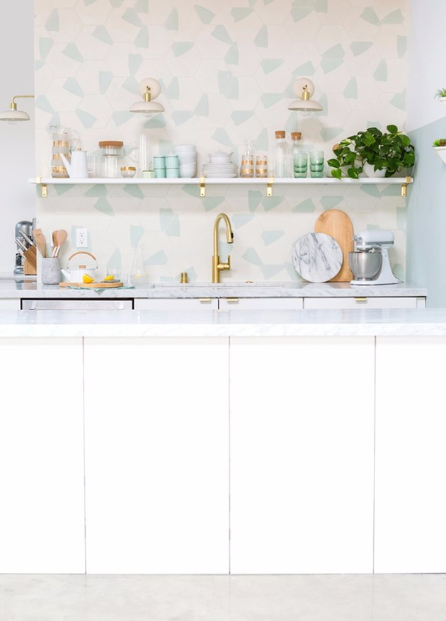 colorful terrazzo pattern tile kitchen backsplash with open shelving and white cabinets