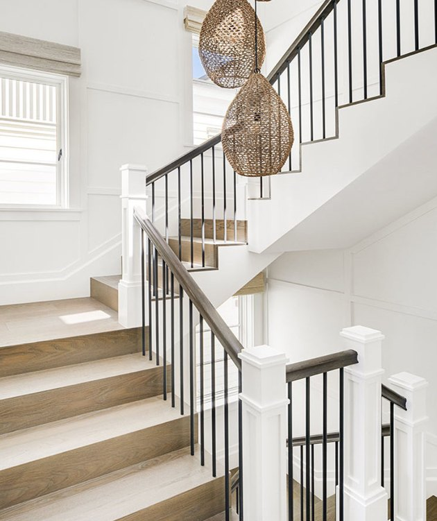 attic stairs ideas with light wood, metal and white staircase with wicker pendant lamps.