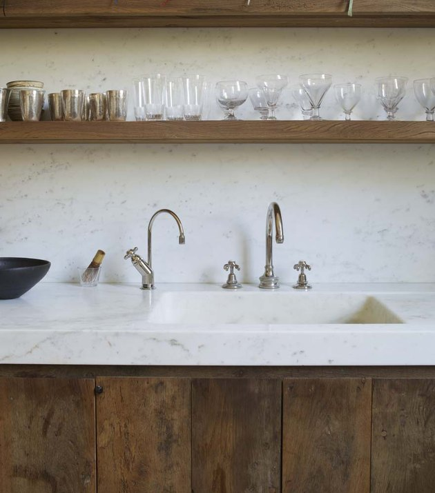 marble countertops and backsplash with integrated sink in rustic kitchen