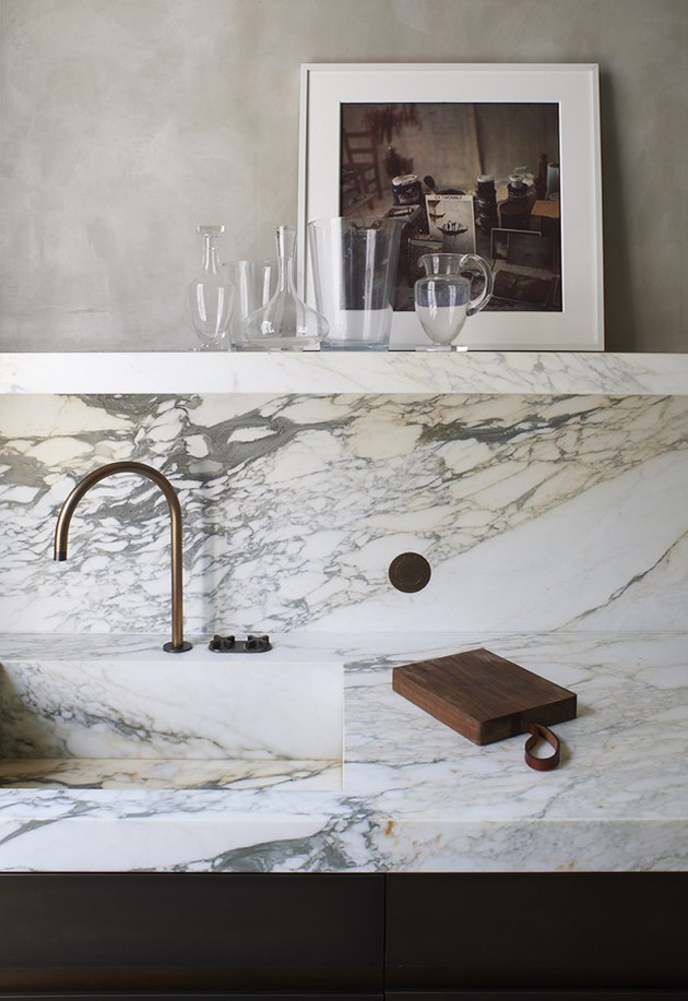 marble integrated sink and backsplash in kitchen
