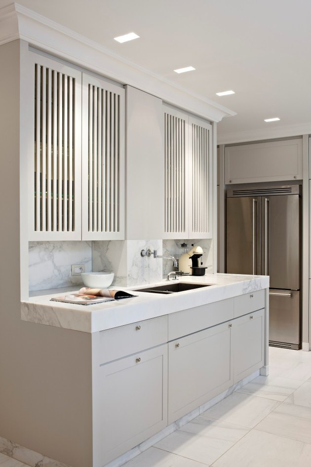 kitchen cabinet style with louvered upper cabinets and thick edge marble countertop