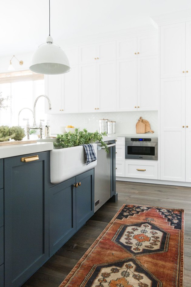 farmhouse-style kitchen with navy and white shaker cabinets