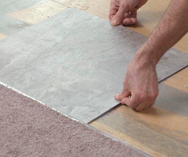 Setting a vinyl tile.