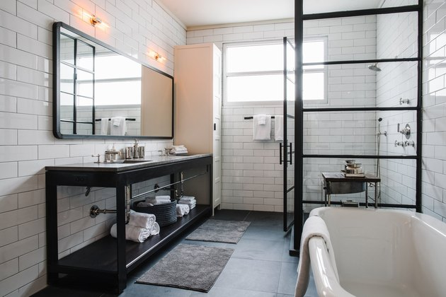 industrial bathroom with white subway tile and concrete countertop on vanity