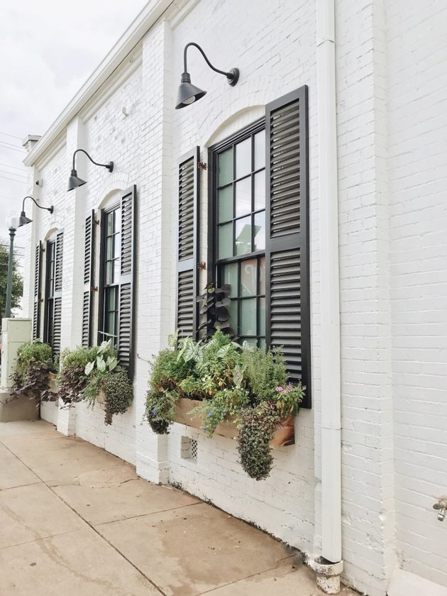 black exterior house shutter ideas with flower boxes