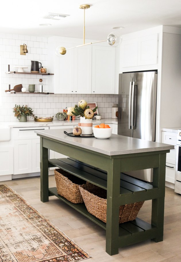 Green freestanding kitchen island idea with gray countertop