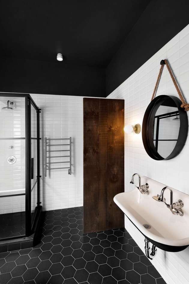 industrial bathroom with wall mount sink and hexagon floor tile