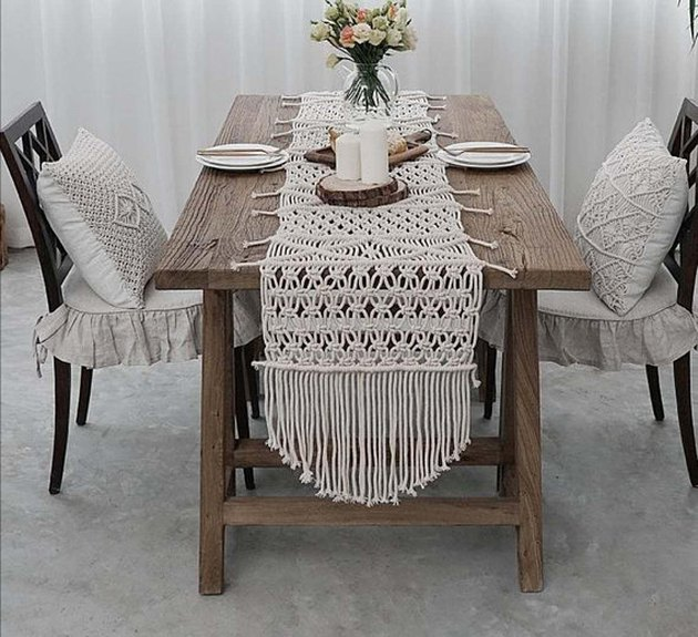 Off-white natural handwoven macrame table runner with fringe at the end