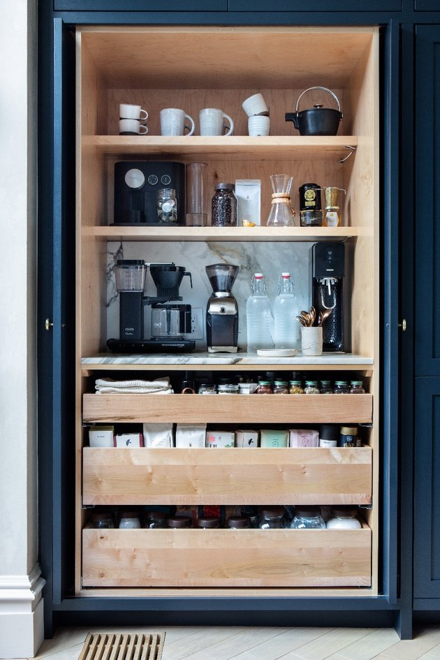 hidden kitchen storage idea for coffee station with pull out drawers