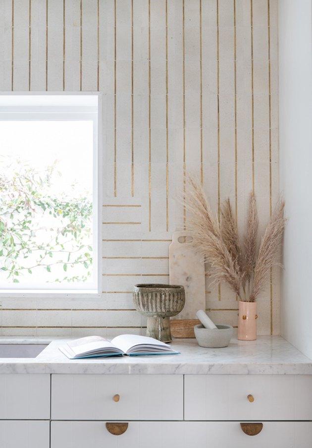 Designlovefest kitchen with white cabinets and patterned tile backsplash