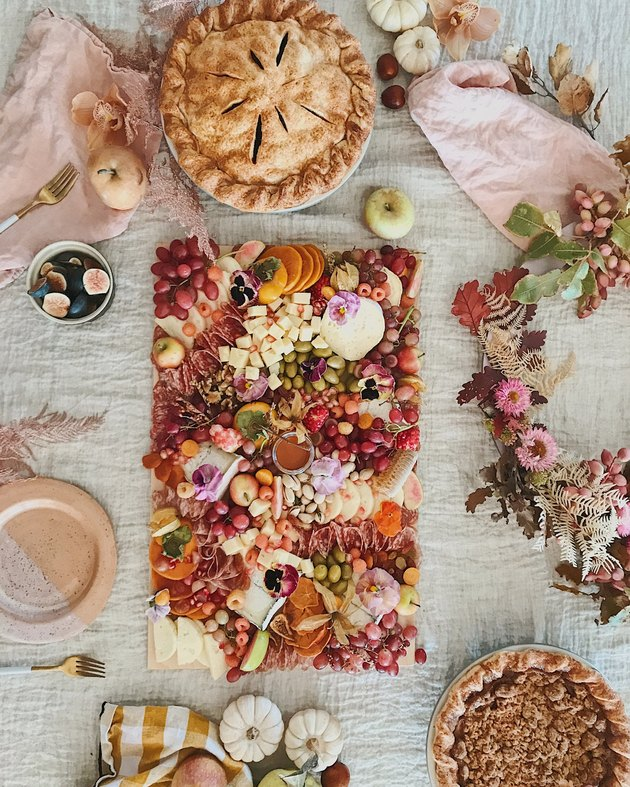 Designlovefest dining table for entertaining with charcuterie tray and pies