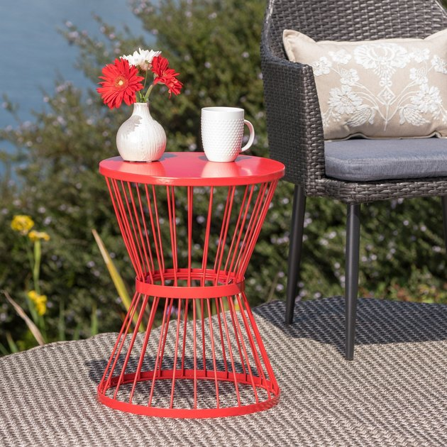 Red wire outdoor side table in outdoor setting